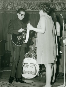 Maggie Finch, President of the UK Fan Club at the time, gives Roy Orbison a gift from the fans.